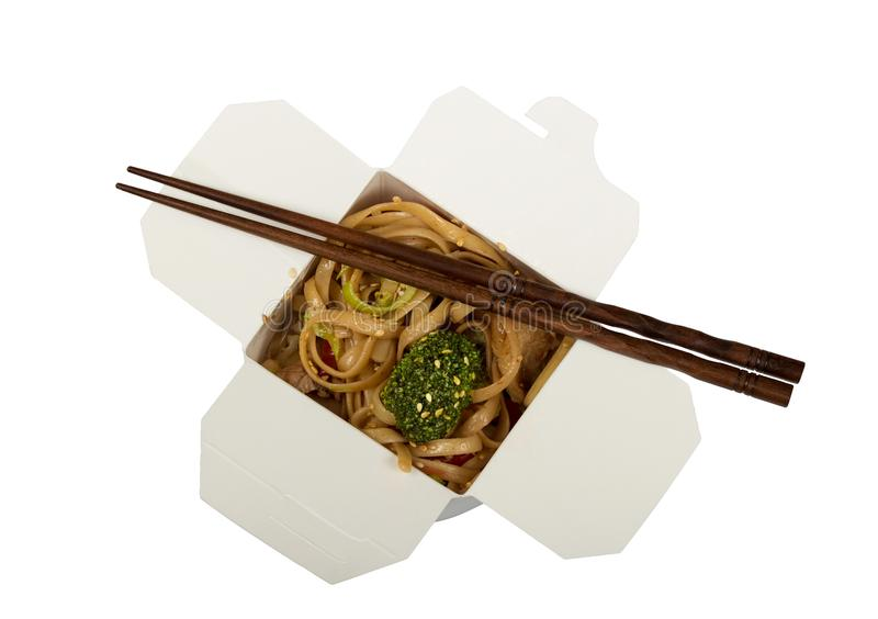 Outdoor lunch box with noodles and vegetables, chopsticks, isolated on white stock photos