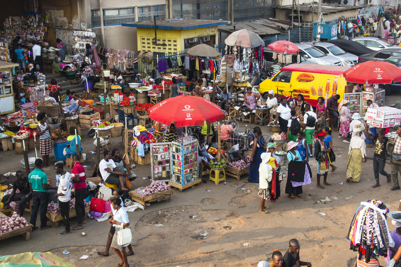 Outdoor market in Kaneshi, Accra, Ghana. ACCRA, GHANA - JANUARY 2016: Outdoor goods stalls at Kaneshi market in Accra, Ghana royalty free stock images