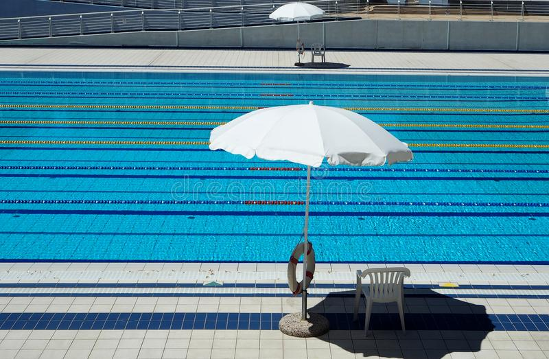 Download Outdoor Olympic Swimming Pool With Lanes For Races And 2 Umbrellas  Per Side For The