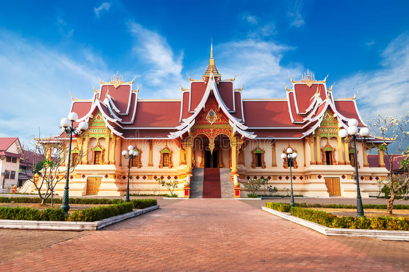 Outdoor park with Buddhist Society Hall. Vientiane, Laos,. Asian architecture. Outdoor park with Buddhist Society Hall at Pha That Luang complex. Vientiane, Laos royalty free stock photos