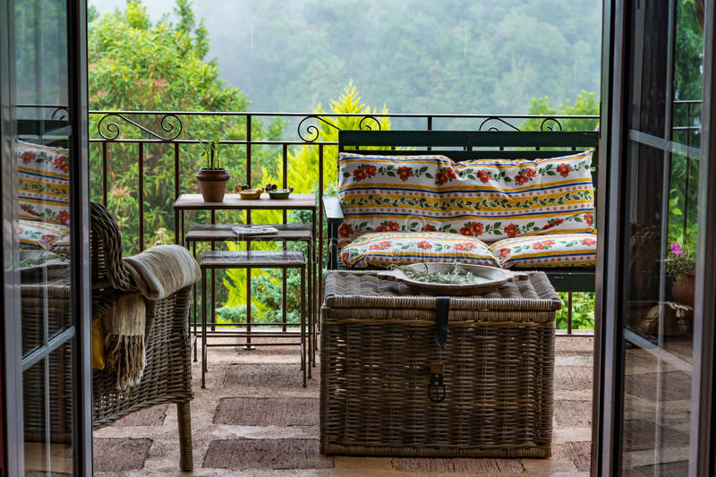 Outdoor patio with retro furniture stock image