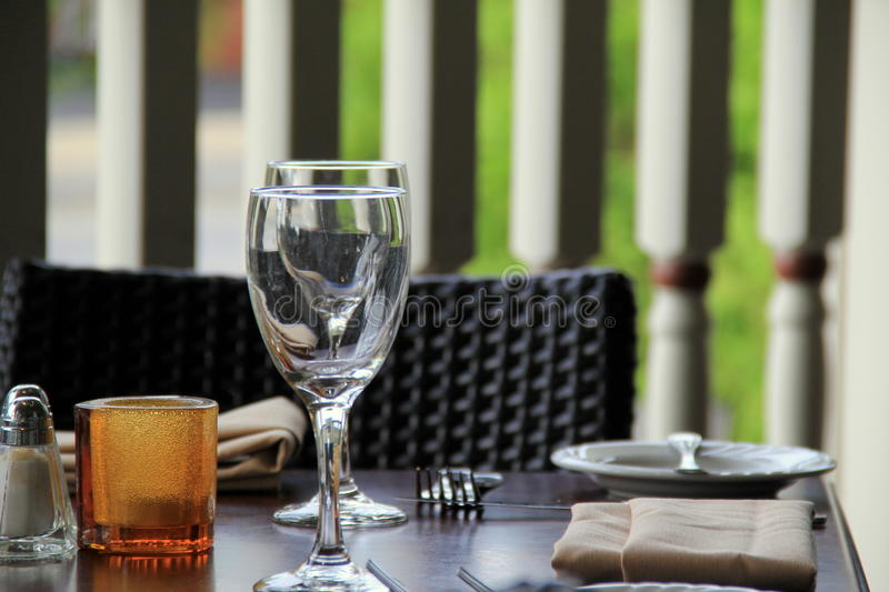 Outdoor patio set and ready for diners stock photos