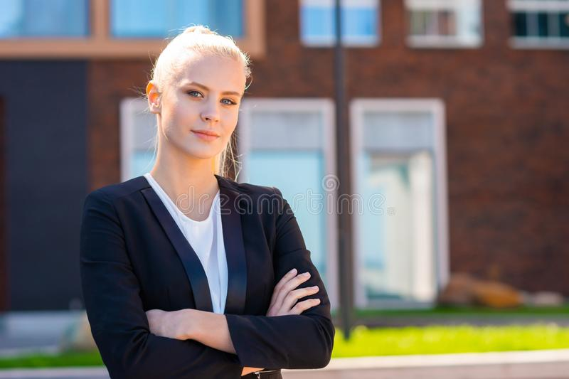 Outdoor photo of young and attractive businesswoman, retailer or student. Woman in casual wear. Real estate, business royalty free stock images