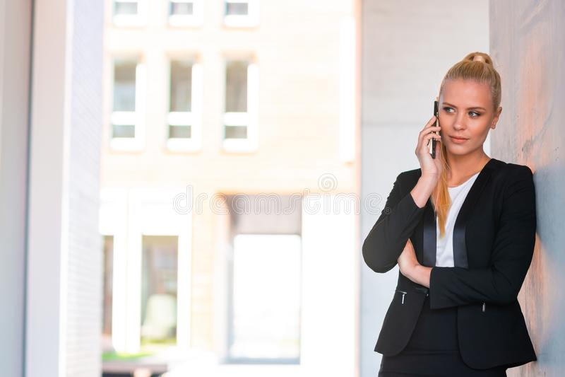 Outdoor photo of young and attractive businesswoman or student. Business and education concept. royalty free stock images