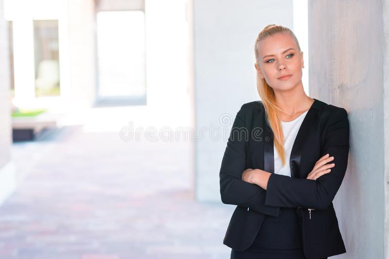 Outdoor photo of young and attractive businesswoman or student. Business and education concept. royalty free stock photo