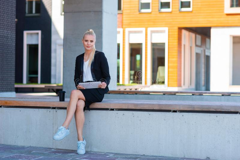 Outdoor photo of young and attractive businesswoman or student. Business and education concept. royalty free stock image