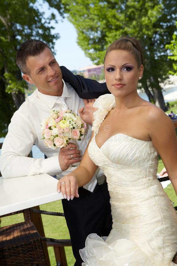 Outdoor photo of young couple on wedding-day. Outdoor photo of attractive young couple on wedding day stock photo