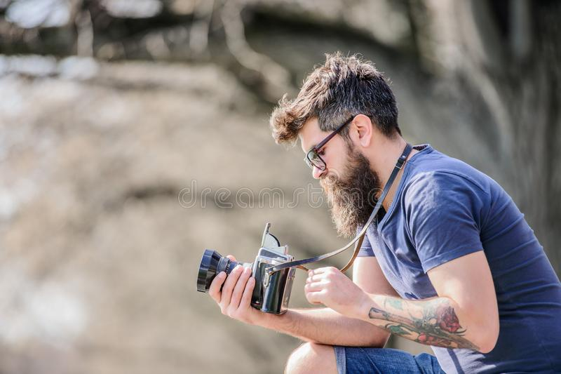 Outdoor photographic equipment. hipster man in sunglasses. brutal photographer with camera. Mature hipster with beard royalty free stock photo