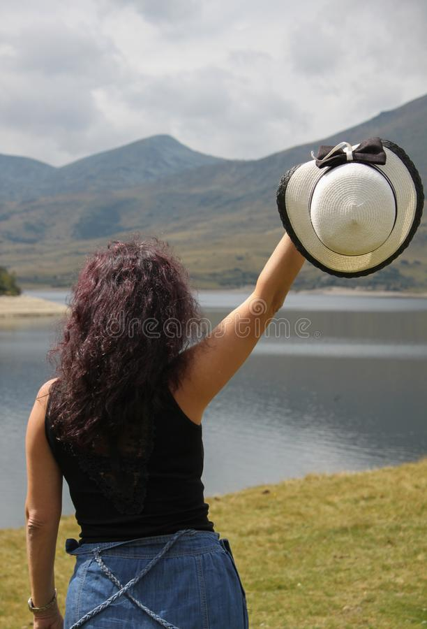 An outdoor picture of a woman with dark curly hair stock photos