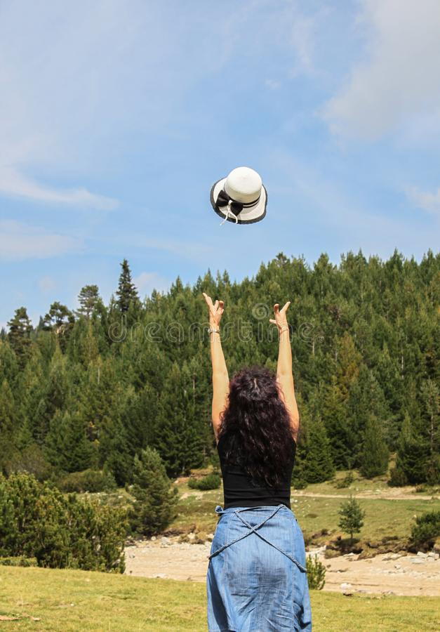 An outdoor picture of a woman with dark curly hair royalty free stock photography