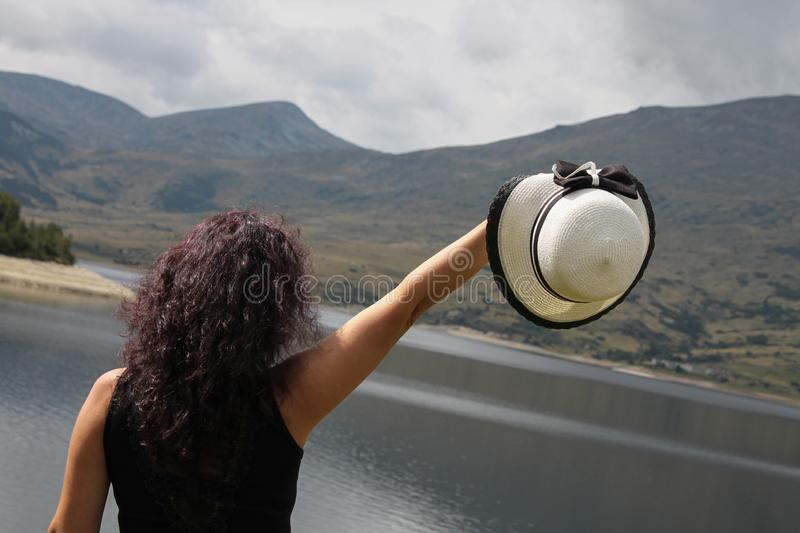 An outdoor picture of a woman with dark curly hair stock images