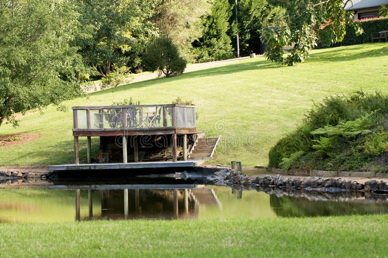 Outdoor platform and table overlooking a dam on a luxury country estate. In Kangaroo valley Australia stock photos