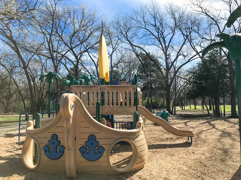 Outdoor playground with children playing wintertime in North Texas, America royalty free stock photography