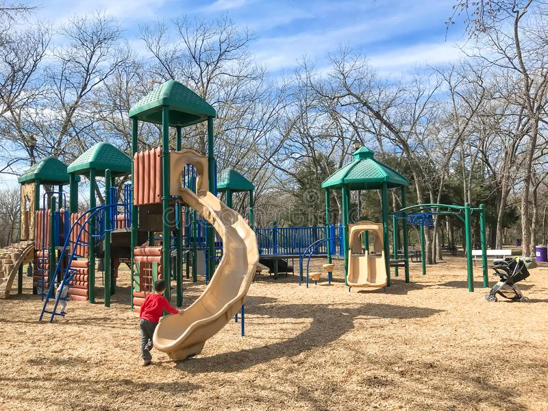 Outdoor playground with children playing wintertime in North Texas, America stock photo