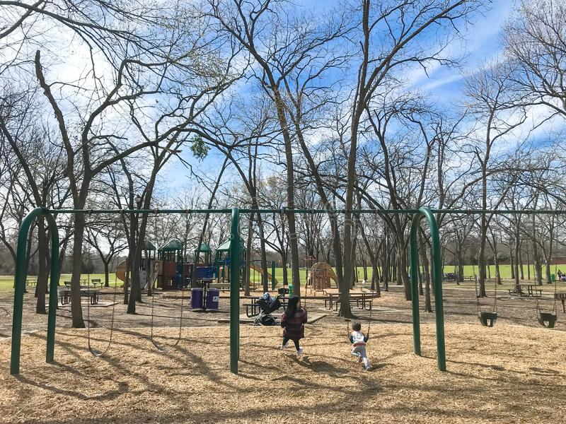 Outdoor playground with children playing wintertime in North Texas, America royalty free stock photos