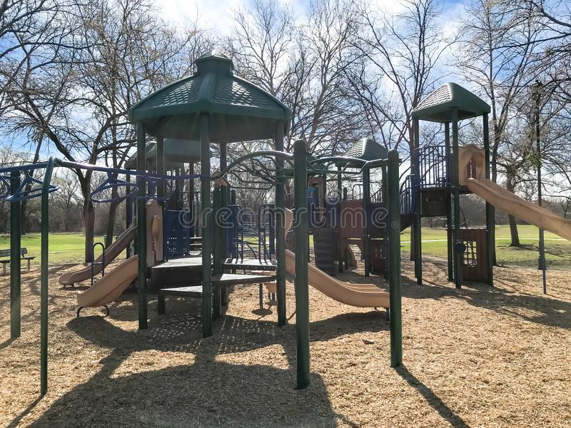 Outdoor playground surrounded by bare trees in wintertime in North Texas, America royalty free stock image