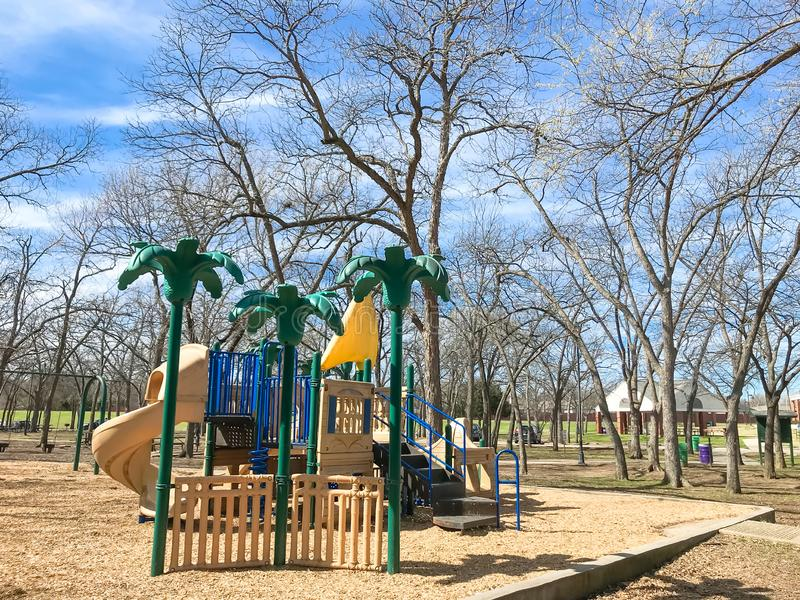 Outdoor playground surrounded by bare trees in wintertime in North Texas, America royalty free stock images