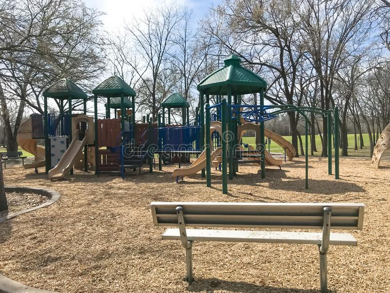Outdoor playground surrounded by bare trees in wintertime in North Texas, America royalty free stock photos
