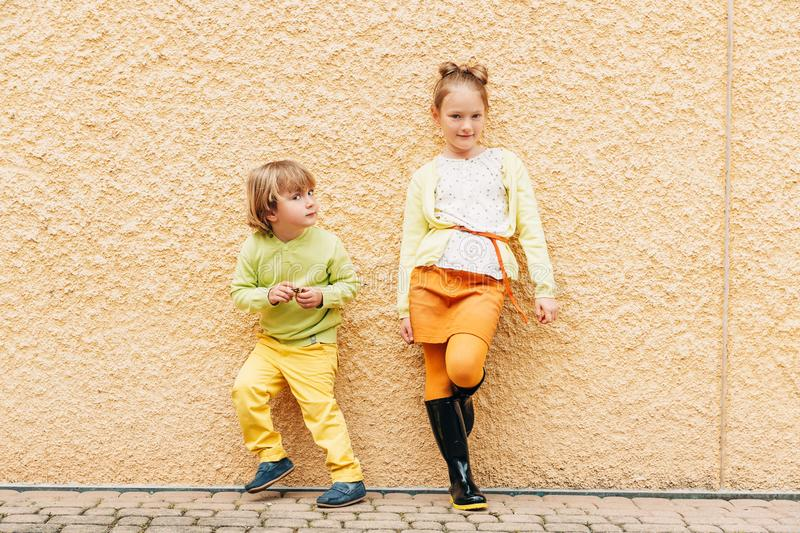 Outdoor portrait of adorable fashion kids royalty free stock image
