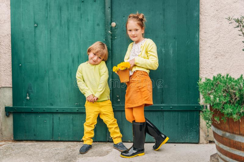 Outdoor portrait of adorable fashion kids royalty free stock images