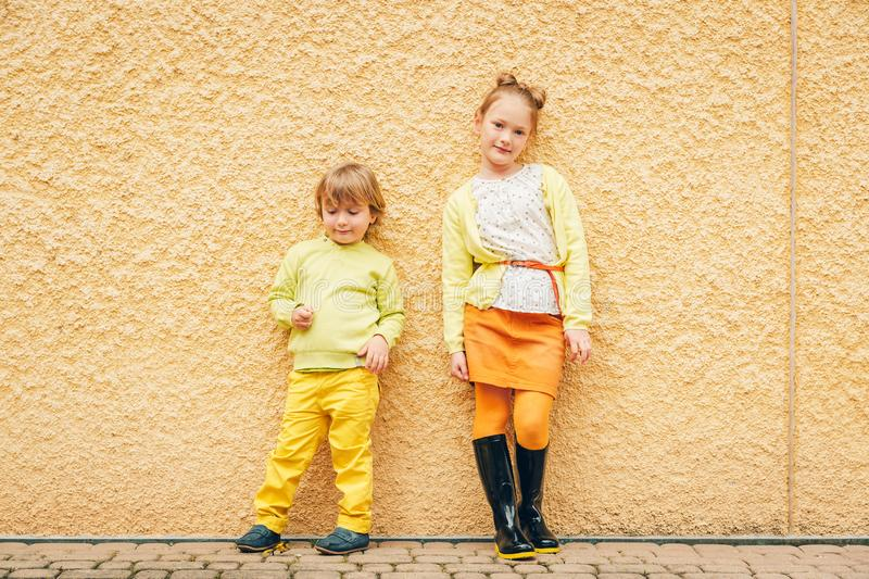 Outdoor portrait of adorable fashion kids stock photo