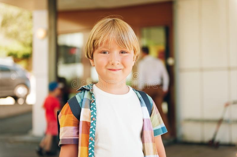 Outdoor portrait of adorable little boy ready to go back to school royalty free stock images