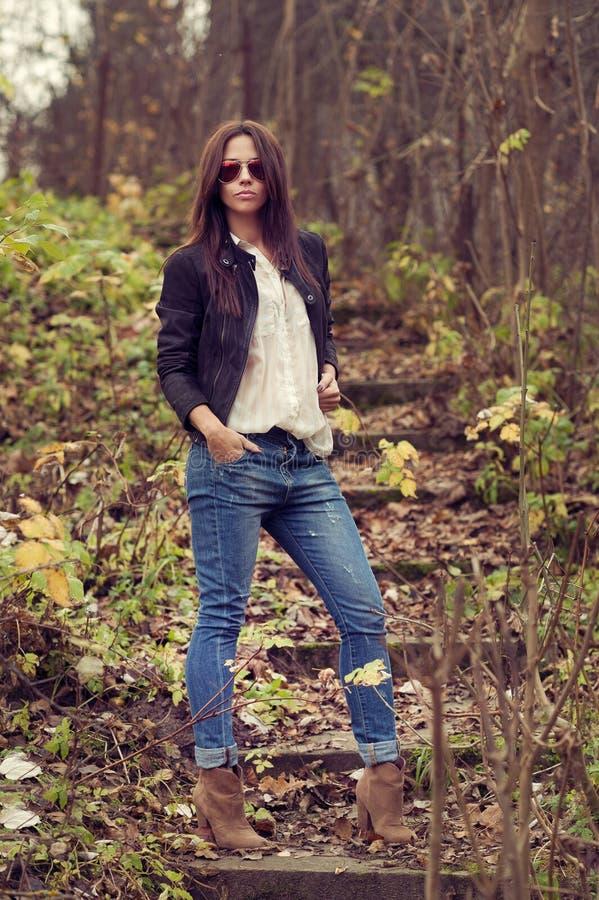 Outdoor portrait of beautiful female model posing wearing sunglasses royalty free stock image