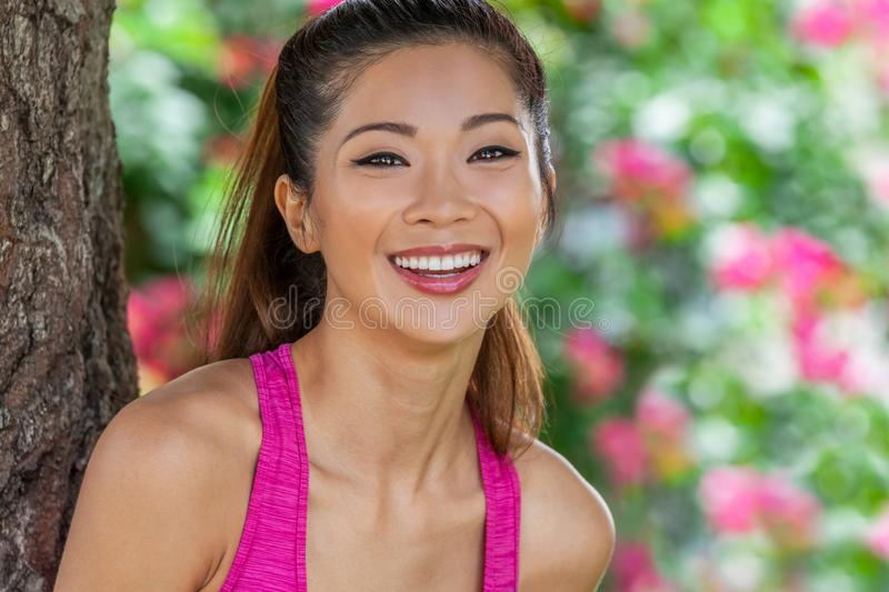 Beautiful Chinese Asian Young Woman Girl Laughing WIth Perfect Teeth royalty free stock images