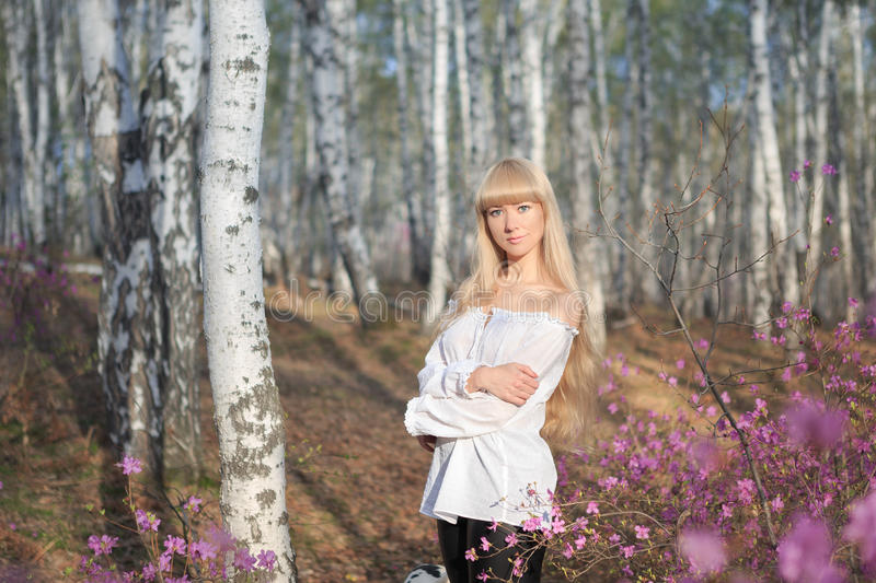 Outdoor portrait of a beautiful middle aged blonde woman. royalty free stock images