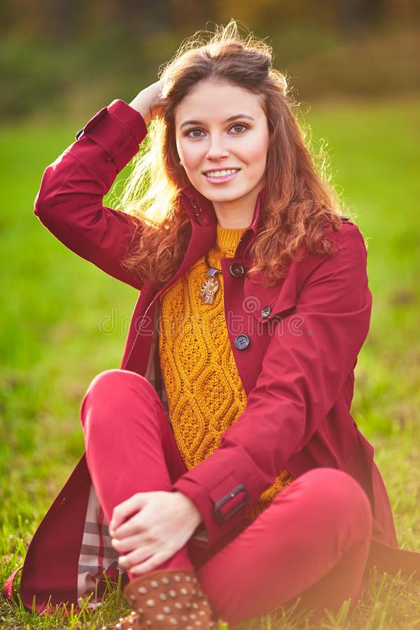 Outdoor portrait of beautiful redhead woman royalty free stock photography