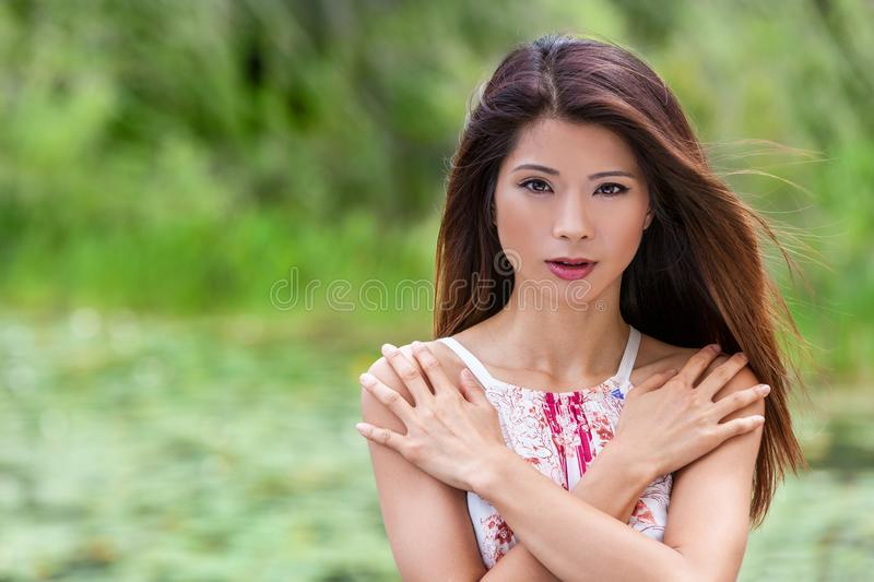 Beautiful Chinese Asian Young Woman Girl Outdoors Natural Green Background stock image