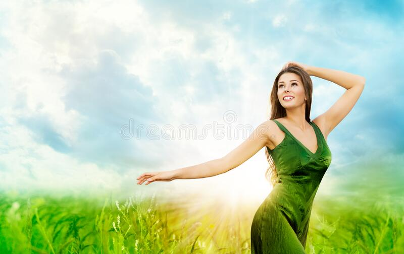 Outdoor Portrait of Beautiful Young Woman. Attractive Girl in Green Field Blue Sunny Sky in Sun Light. Outdoor Portrait of Beautiful Young Woman. Attractive Girl stock photos