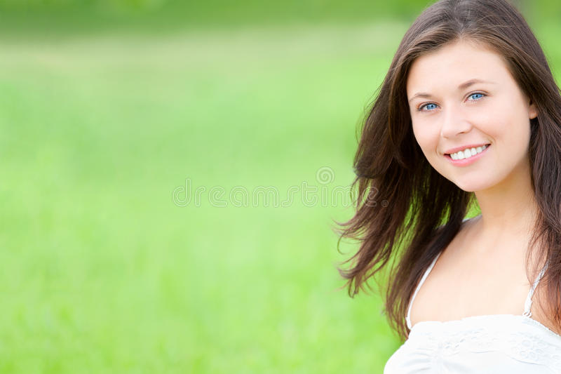 Outdoor portrait of a beautiful young woman, closeup royalty free stock photos