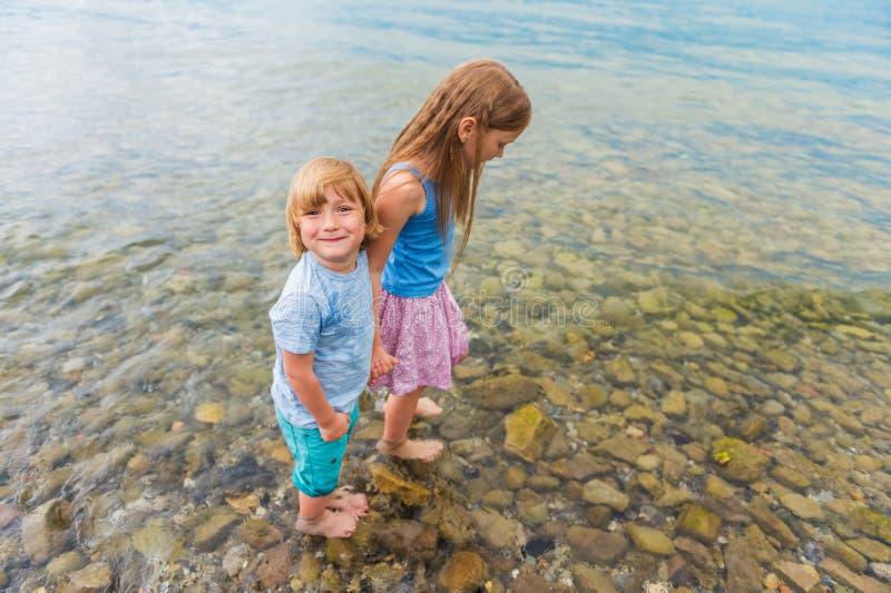 Outdoor portrait of cute kids stock photos