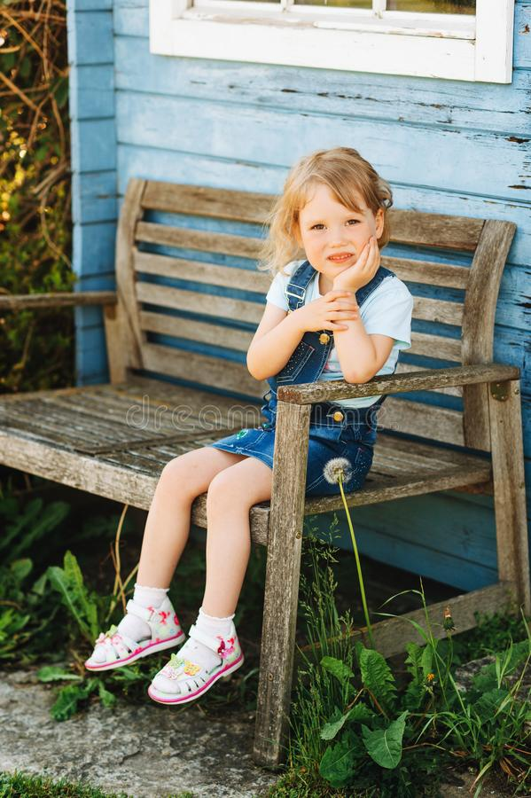 Outdoor portrait of cute little 3-4 year old girl royalty free stock images