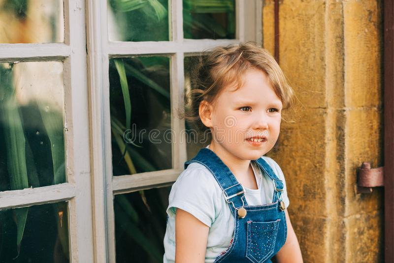 Outdoor portrait of cute little 3-4 year old girl royalty free stock photo