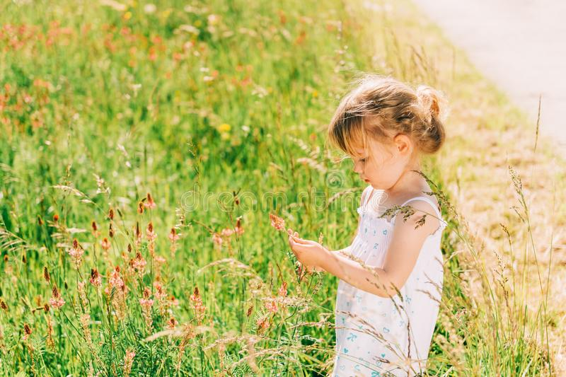 Outdoor portrait of cute little 3-4 year old girl stock photography