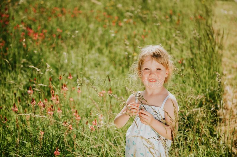 Outdoor portrait of cute little 3-4 year old girl stock images