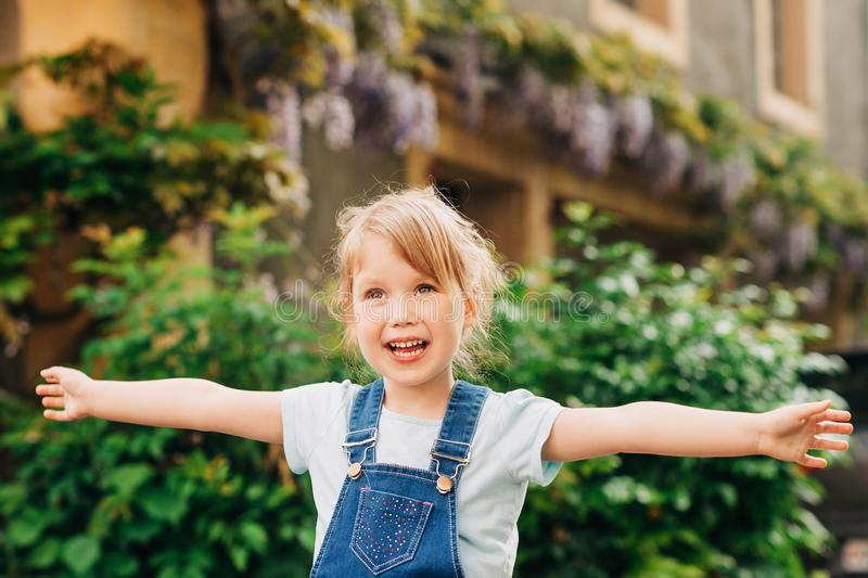 Outdoor portrait of cute little 3-4 year old girl royalty free stock photography