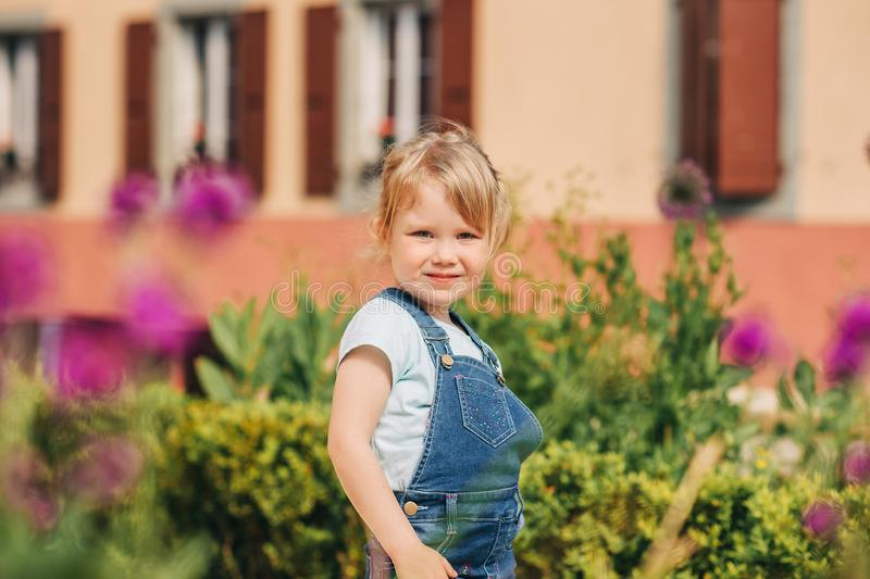 Outdoor portrait of cute little 3-4 year old girl royalty free stock photos