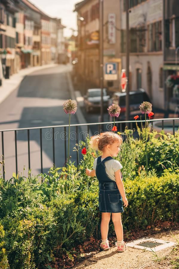 Outdoor portrait of cute little 3-4 year old girl stock photos