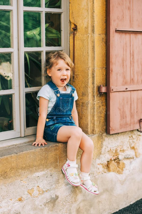 Outdoor portrait of cute little 3-4 year old girl stock photo