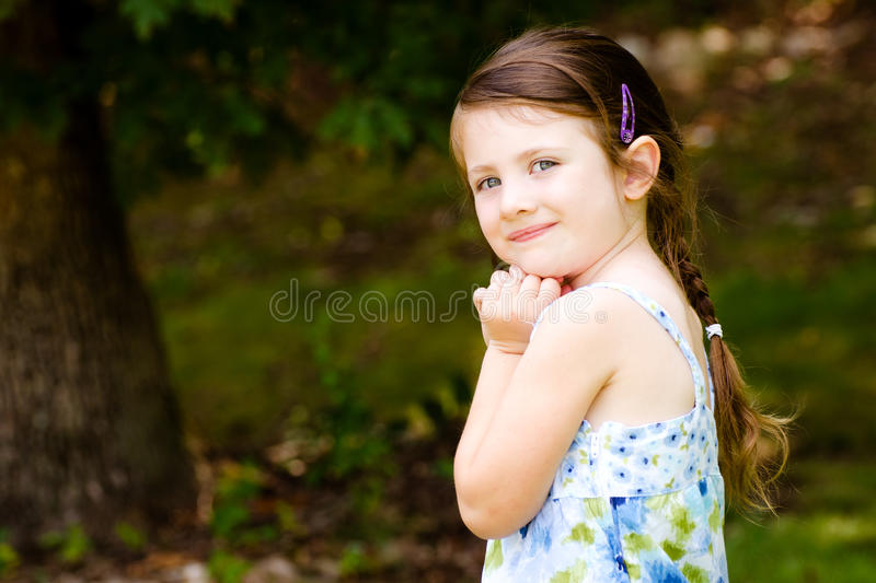 Outdoor portrait of cute young girl stock photos