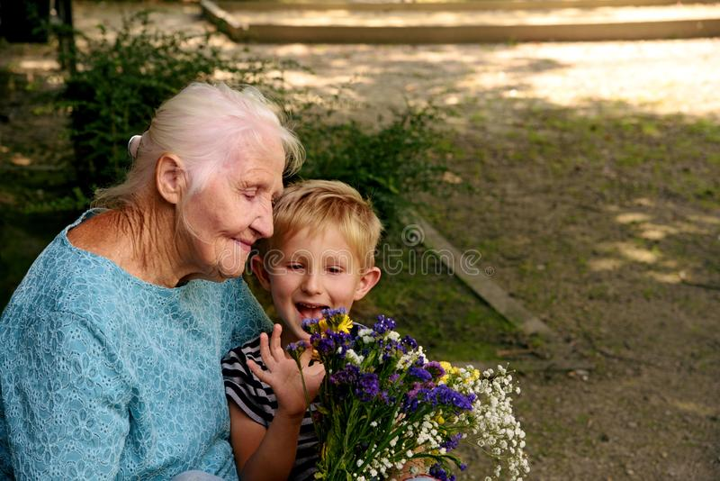 Elderly woman with grandson royalty free stock photo