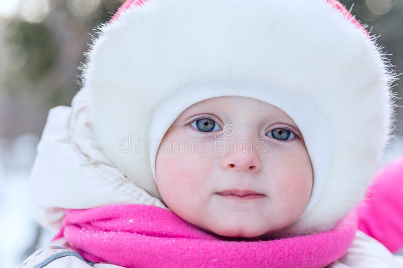 Outdoor portrait face of a little girl in a cap close-up in on t royalty free stock images