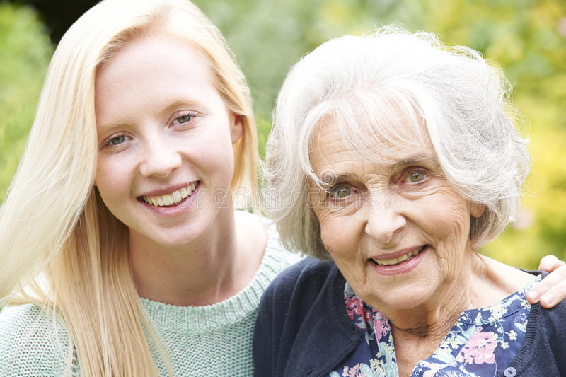 Outdoor Portrait Of Grandmother And Granddaughter. Outdoor Portrait Of Happy Grandmother And Granddaughter stock photo