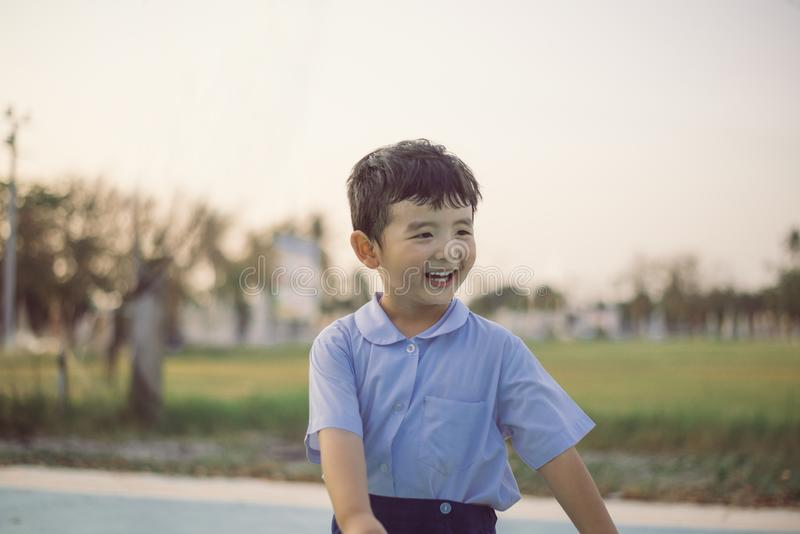 Outdoor portrait of a happy Asian student kid in school uniform smiling stock photos