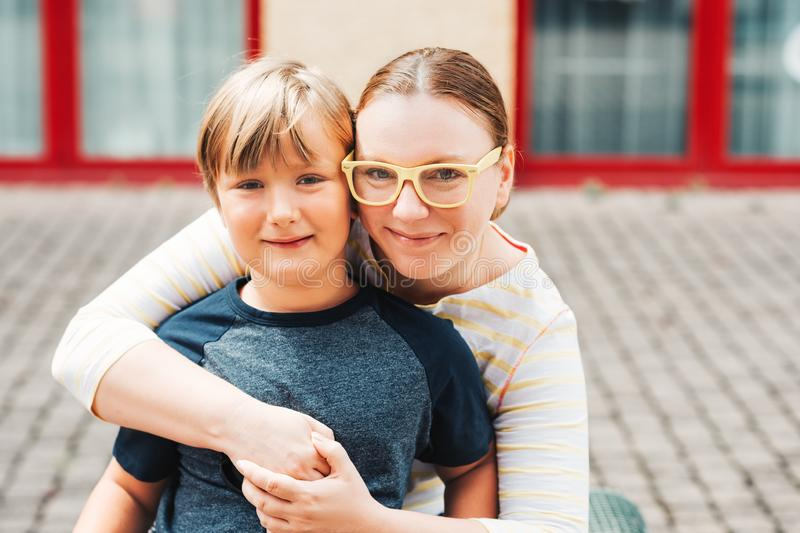 Outdoor portrait of happy mother with cute son stock photography