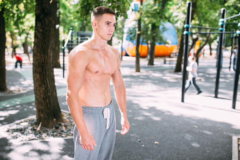 Outdoor portrait of healthy handsome active man with fit muscular body, sports and fitness concept.  stock images