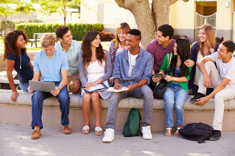 Outdoor Portrait Of High School Students On Campus stock photos